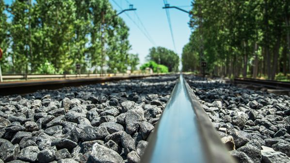 Rubber-coated ballast demonstrates improved track resilience